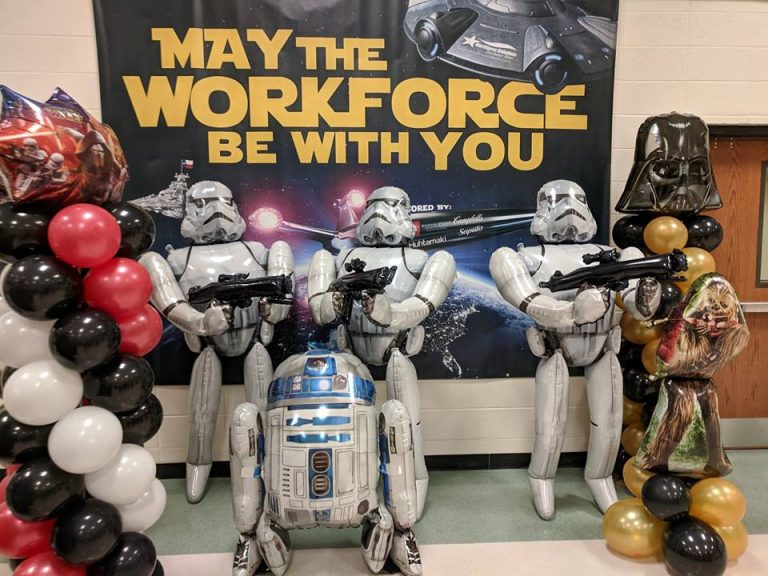 storm troopers in front of workforce poster
